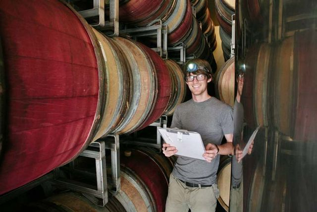 1ojai_winery_california_evan_checking_the_barrels