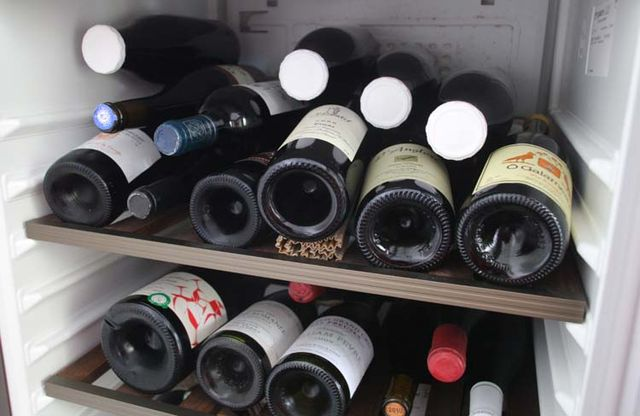 1wine_in_milk_bottles_laying_down_cellar