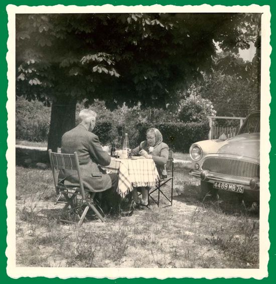 1middle-aged-couple_eating_near_car_june1962