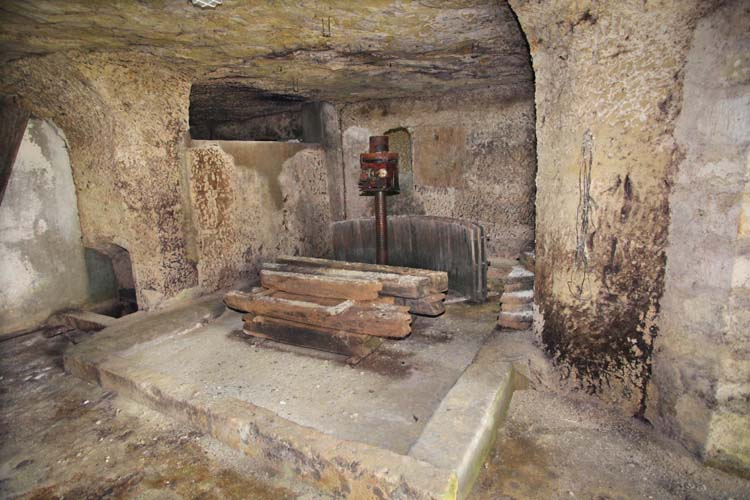 1mikael_bouges_ancient_press_embedded_in_rock