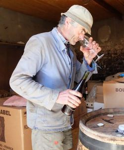 1michel_guignier_checking_opened_bottle_oh2014