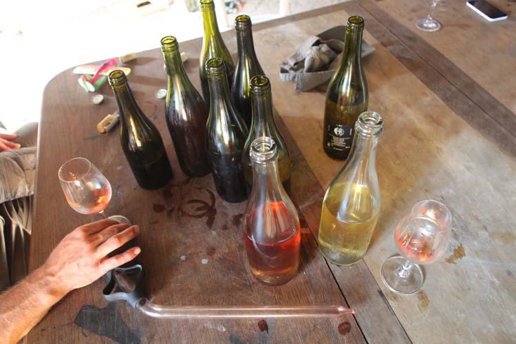 1reynald_heaule_table_bottles_hand